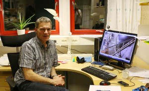 Arne Aalberg sits in his office at UNIS in Longyearbyen. His computer shows an early mock-up of a design for a snow pressure-plate measuring device. Photo by Nancy Brazilchuk / NTNU