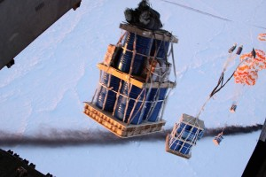 Cargo attached to parachutes is dropped onto the Barneo ice floe. Photo by