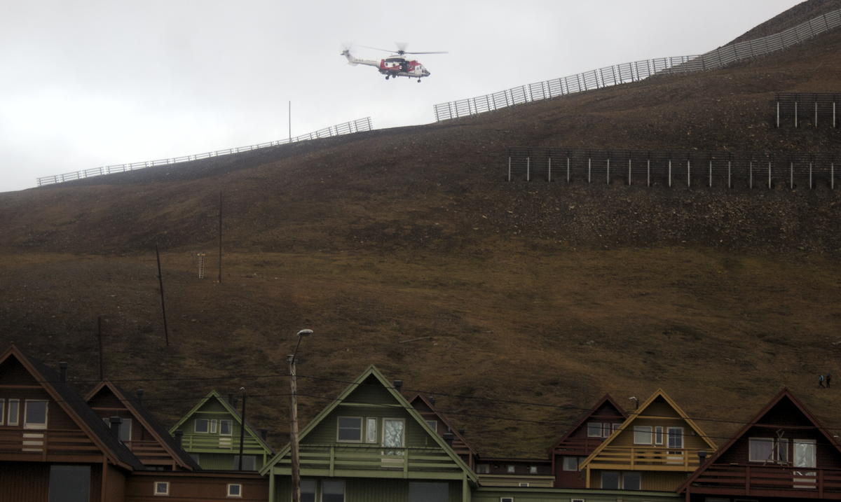 HELICOPTER HOVERING IN THE NEIGHBORHOOD: Rescuers searching for missing hiker above homes mystifies residents