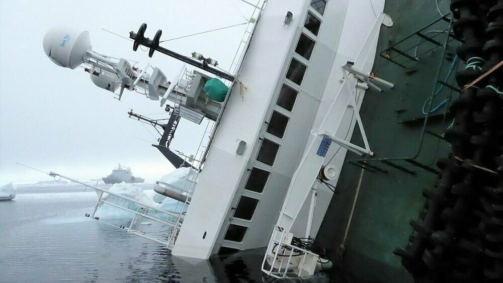 HIGH NEGLIGENCE: Owner and captain of Northguider fined total of 330,000 kr. for wrecking trawler in north Svalbard, necessitating rescue of crew and multiyear removal effort